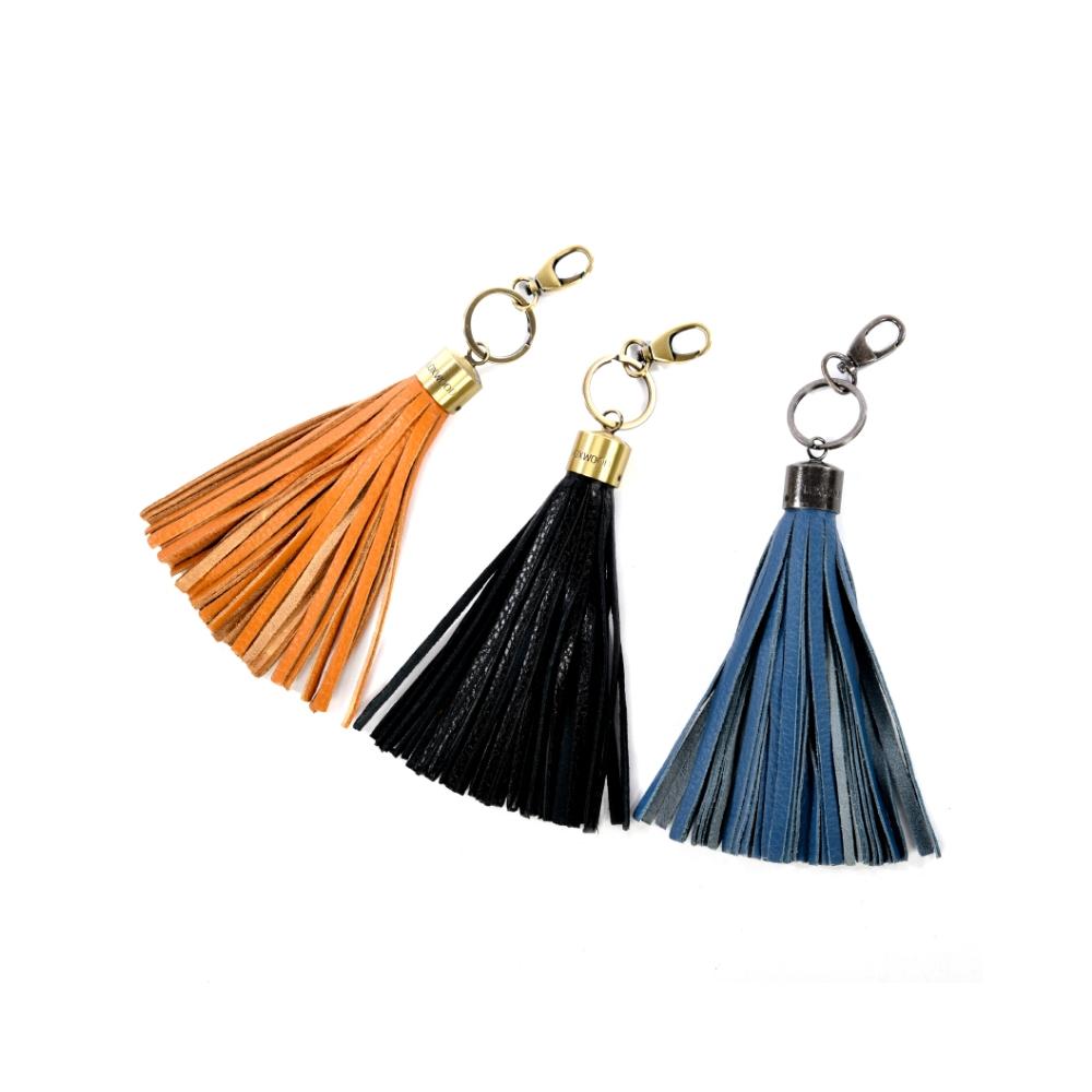 Bijou de sac pompon cuir noir for Porte cle pompon h m